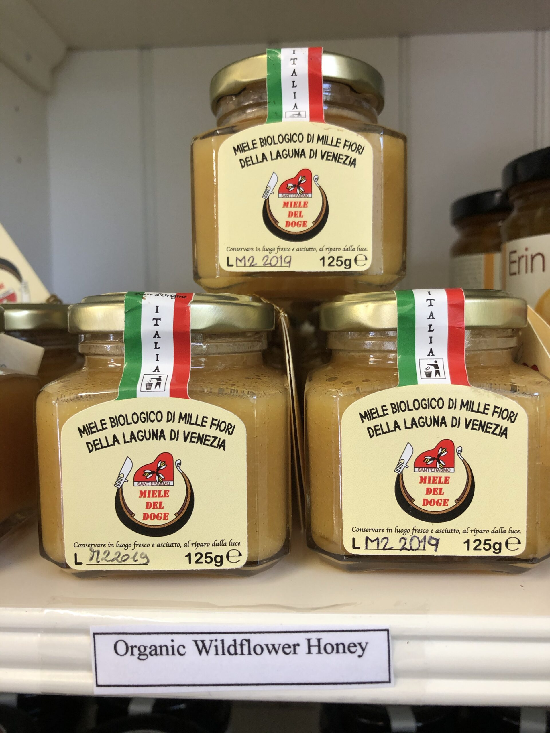 Jars of Miele del Doge honey stacked ontop of each other